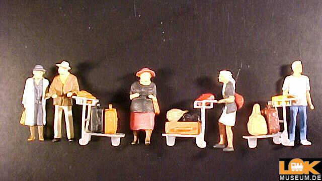 Reisende mit Kofferkulis